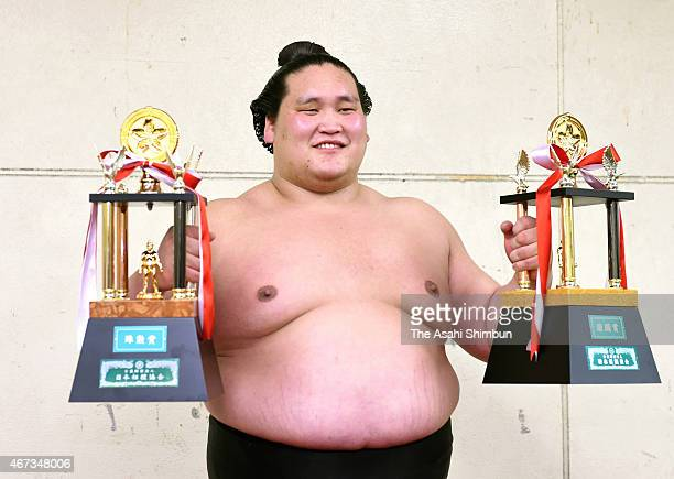 Mongolian sekiwake Terunofuji poses for photographs after day fifteen of the Grand Sumo Spring Tournament at Bodymaker Colosseum on March 22 2015 in...