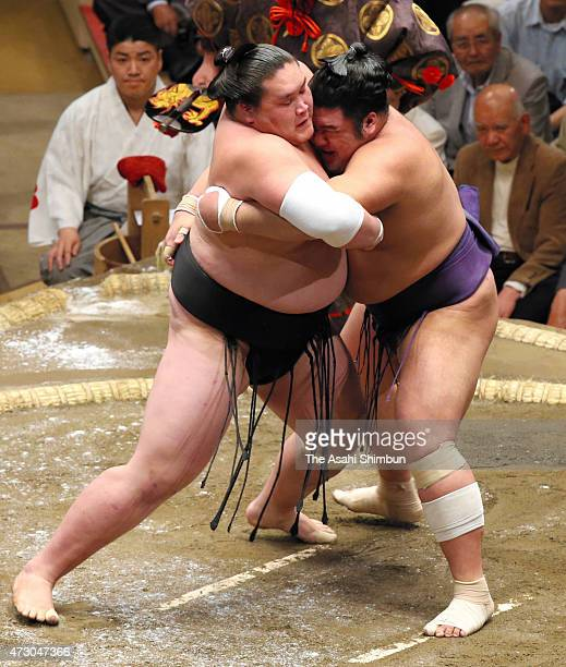 Mongolian sekiwake Terunofuji pushes Tochiozan out of the ring to win during day three of the Grand Sumo Summer Tournament at Ryogoku Kokugikan on...