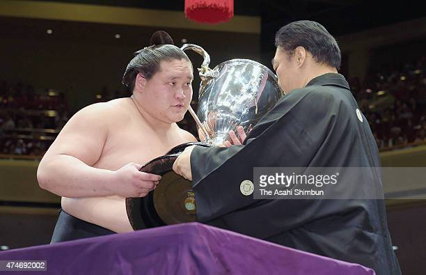 Mongolian sekiwake Terunofuji receives the trophy after winning the tournament on the day 15 of the Grand Sumo Summer Tournament at Ryogoku Kokugikan...