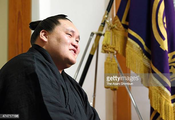 Mongolian sekiwake Terunofuji speaks during a press conference a day after his first win of the tournament at Isegahama stable on May 25 2015 in...
