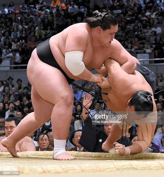 Mongolian sekiwake Terunofuji throws Toyonoshima to win during day twelve of the Grand Sumo Spring Tournament at Bodymaker Colosseum on March 19 2015...