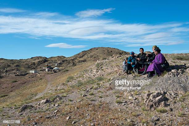Mongolian senior women resting during an outing to the Ongiin Khiid monastery in central Mongolia