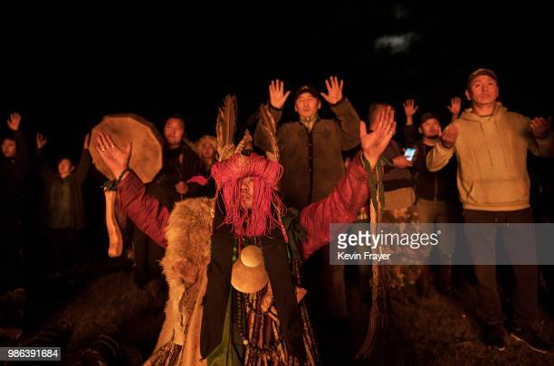 Mongolian Shaman or Buu and followers take part in a fire ritual meant to summon spirits to mark the period of the Summer Solstice early June 24 2018...