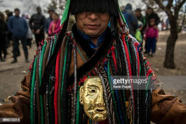Mongolian Shaman or Buu is seen at a fire ritual meant to summon spirits at the Mother Tree on April 05 2018 in Sukhbaatar Selenge Province Mongolia...