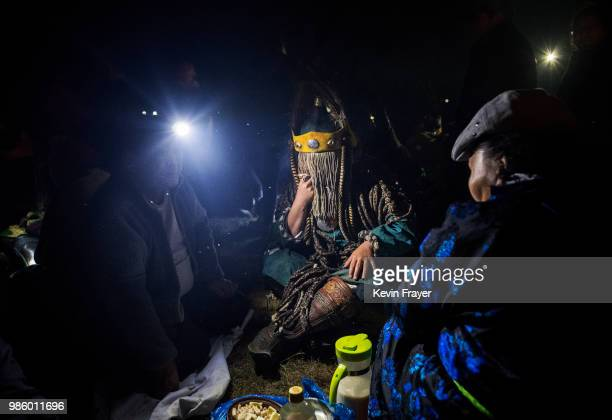 Mongolian Shaman or Buu is seen in trance while being consulted by followers of Shamanism or Buu murgul at a fire ritual meant to summon spirits to...