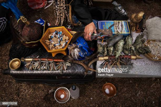 Mongolian Shaman or Buu organizes his items for rituals meant to summon spirits at the Mother Tree on April 05 2018 in Sukhbaatar Selenge Province...