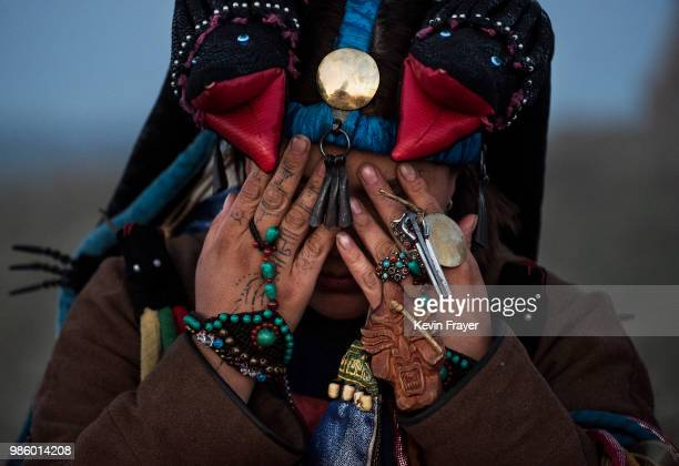 Mongolian Shaman or Buu prays during a sun ritual ceremony to mark the period of the Summer Solstice in the grasslands at sunrise on June 22 2018...
