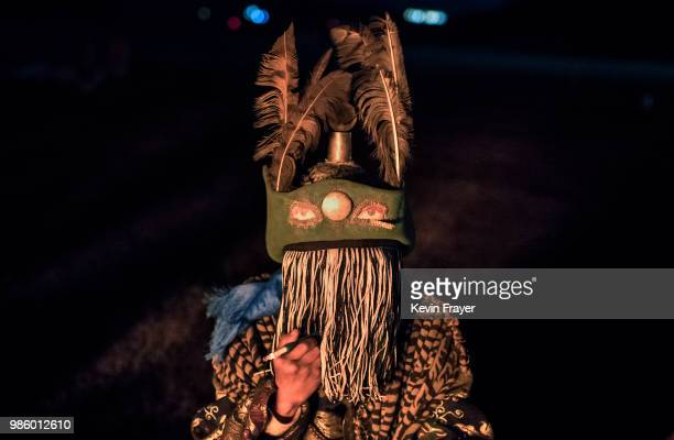 Mongolian Shaman or Buu smokes as he is seen in trance while being consulted by followers of Shamanism or Buu murgul at a fire ritual meant to summon...