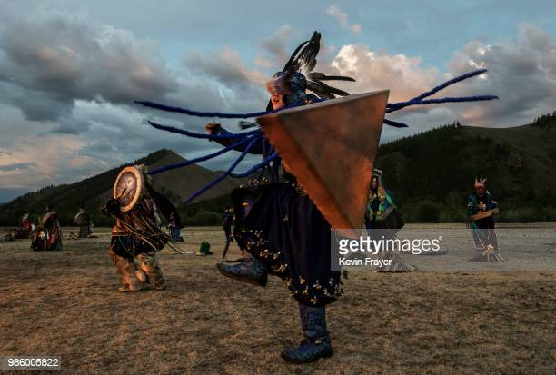 Mongolian Shaman or Buu takes part in a fire ritual meant to summon spirits to mark the period of the Summer Solstice in the grasslands on June 22...