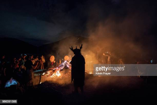 Mongolian Shamans or Buu and their followers gather as they take part in a fire ritual meant to summon spirits to mark the period of the Summer...