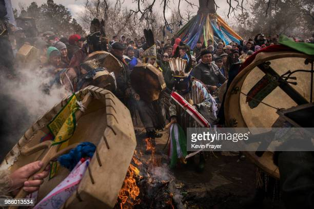 Mongolian Shamans or Buu and their followers take part in a fire ritual meant to summon spirits at the Mother Tree on April 05 2018 in Sukhbaatar...