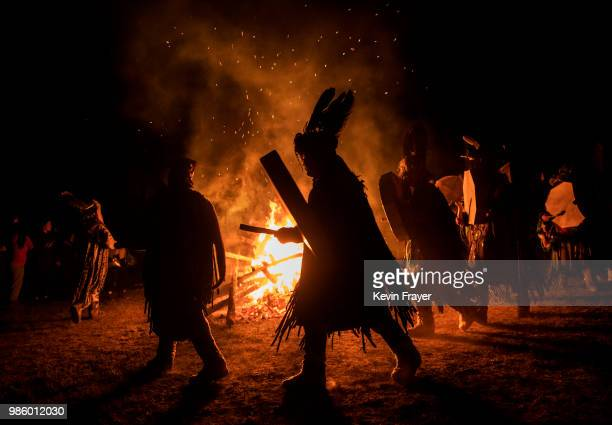 Mongolian Shamans or Buu beat their drums as they take part in a fire ritual meant to summon spirits to mark the period of the Summer Solstice in the...