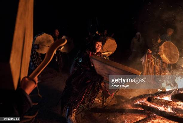Mongolian Shamans or Buu dance and beat their drums as they take part in a fire ritual meant to summon spirits to mark the period of the Summer...