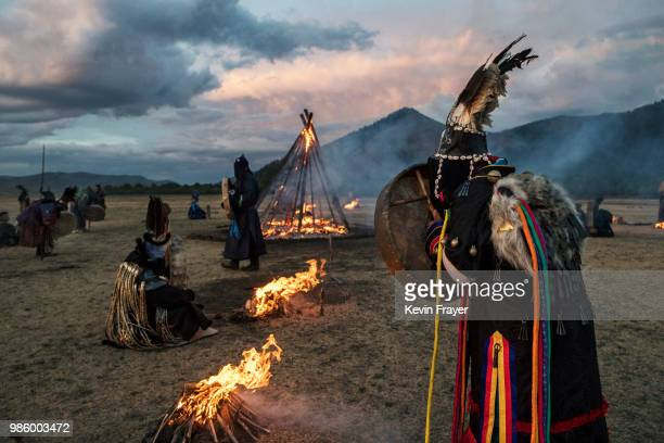 Mongolian Shamans or Buu gather as they take part in a fire ritual to mark the period of the Summer Solstice in the grasslands on June 22 2018...