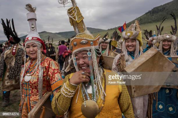 Mongolian Shamans or Buu gather before a fire ritual meant to summon spirits to mark the period of the Summer Solstice on June 23 2018 outside...
