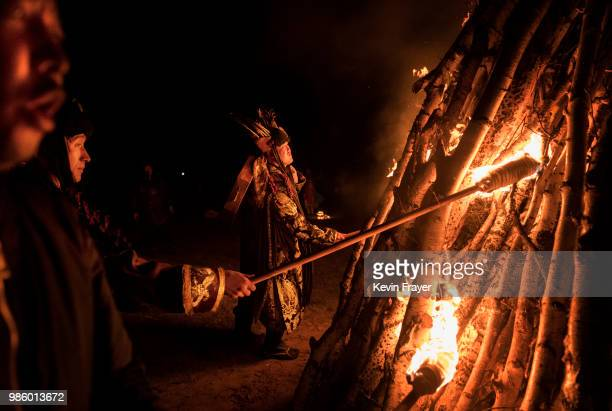 Mongolian Shamans or Buu light a large fire as they take part in a fire ritual meant to summon spirits to mark the period of the Summer Solstice...