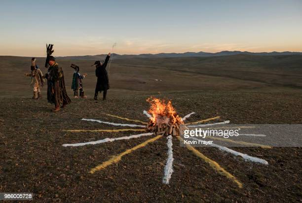 Mongolian Shamans or Buu make offerings as they take part in a sun ritual ceremony to mark the period of the Summer Solstice in the grasslands on...