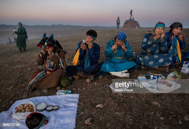 Mongolian Shamans or Buu play the mouth harp or khel khurr used to summon spirits during a sun ritual ceremony to mark the period of the Summer...