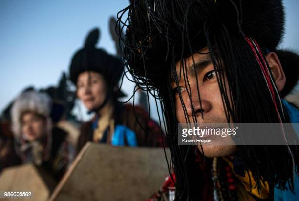 Mongolian Shamans or Buu sit together as they take part in a sun ritual ceremony to mark the period of the Summer Solstice in the grasslands on June...