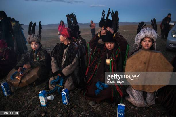 Mongolian Shamans or Buu sit together as they take part in a sun ritual ceremony to mark the period of the Summer Solstice in the grasslands at...