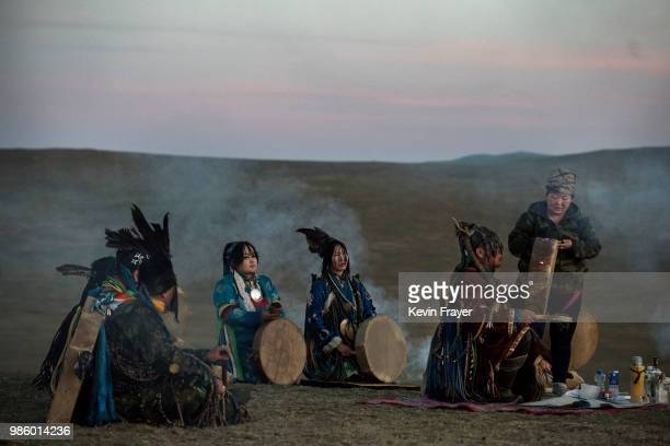 Mongolian Shamans or Buu take part in a sun ritual ceremony to mark the period of the Summer Solstice in the grasslands at sunrise on June 22 2018...