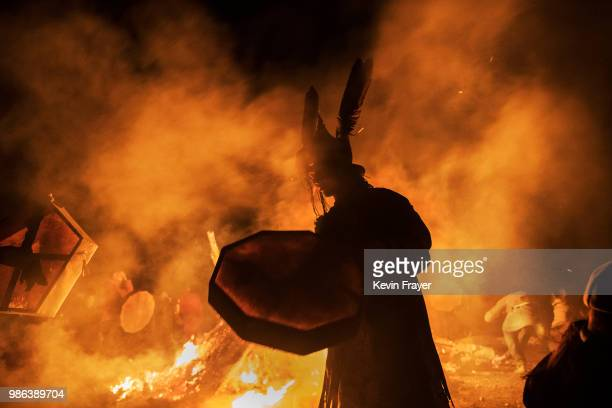 Mongolian Shamans or Buu takes part in a fire ritual meant to summon spirits to mark the period of the Summer Solstice early June 24 2018 outside...