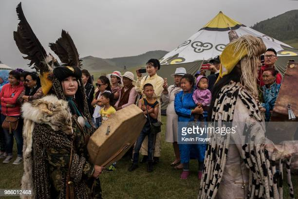 Mongolian Shamans or Buu walk passed followers before a fire ritual meant to summon spirits to mark the period of the Summer Solstice on June 23 2018...