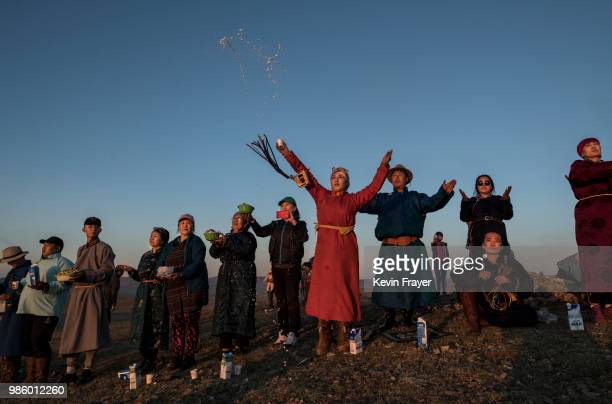 Mongolian Shamans or Buuand their followers throw milk as an offering during a sun ritual ceremony to mark the period of the Summer Solstice in the...