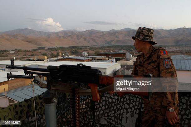 Mongolian soldier guards a watch tower at the PRT on September 30 2010 in Feyzabad Afghanistan Badakhshan province was free of Taliban until about a...