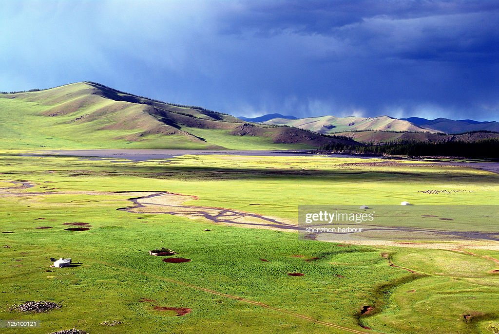 Green landscape with small hill located slightly west to country's center, on northern slopes of Khangai mountains.
