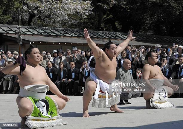 "Mongolian sumo grand champion Asashoryu offers a ritual entrance into the ring during the ""Honozumo,"" a ceremonial sumo tournament, at the Yasukuni..."