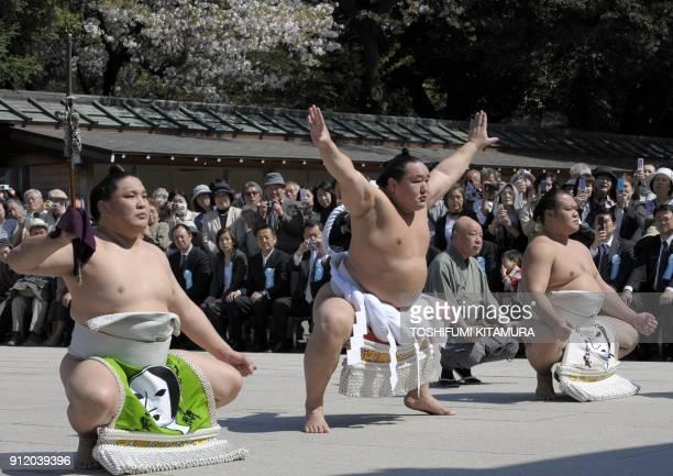 Mongolian sumo grand champion Asashoryu offers a ritual entrance into the ring during the 'Honozumo' a ceremonial sumo tournament at the Yasukuni...