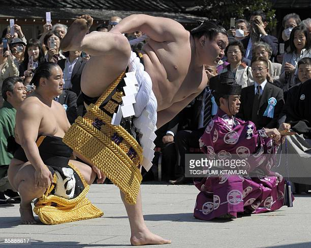 """Mongolian sumo grand champion Hakuho offers a ritual entrance into the ring during the """"Honozumo,"""" a ceremonial sumo tournament, at the Yasukuni..."""