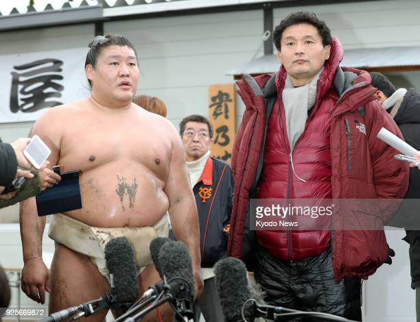 Mongolian sumo wrestler Takanoiwa speaks to reporters alongside his stablemaster Takanohana at his stable in Uji western Japan on March 1 2018...