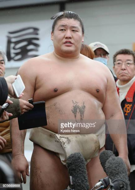 Mongolian sumo wrestler Takanoiwa speaks to reporters at his stable in Uji western Japan on March 1 2018 Takanoiwa who was injured in a beating by...