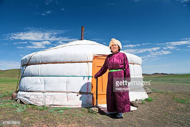 mongolian woman in national clothing standing next to ger - mongolian women stock photos and pictures