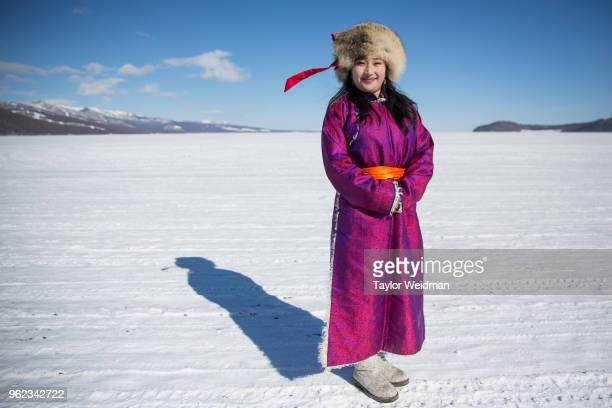 Mongolian woman stands for a portrait at the Lake Khovsgol Ice Festival in Khatgal Mongolia