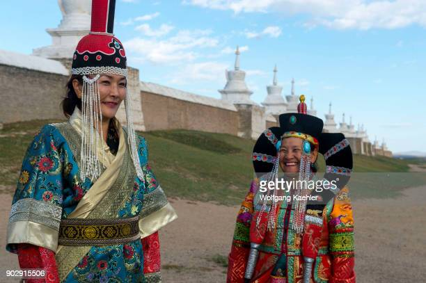 Mongolian women dressed in historic costume in front of the wall with stupas surrounding the Erdene Zuu monastery in Kharakhorum a UNESCO World...