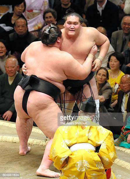 Mongolian wrestler Ichinojo pushes Mongolian ozeki Terunofuji out of the ring to win during day three of the Grand Sumo New Year Tournament at...