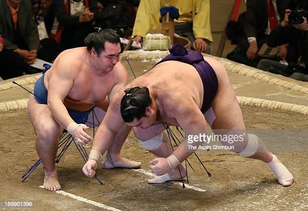 Mongolian wrestler Kakuryu whose real name is Mangaljalavyn Anand throws Brazilian wrestler Kaisei whose real name is Ricardo Sugano to win during...