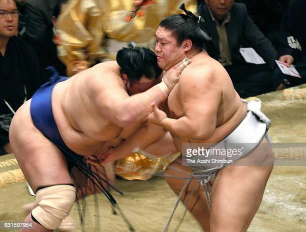Mongolian wrestler Takanoiwa and Hokutofuji compete during day six of the Grand Sumo New Year Tournament at Ryogoku Kokugikan on January 13 2017 in...