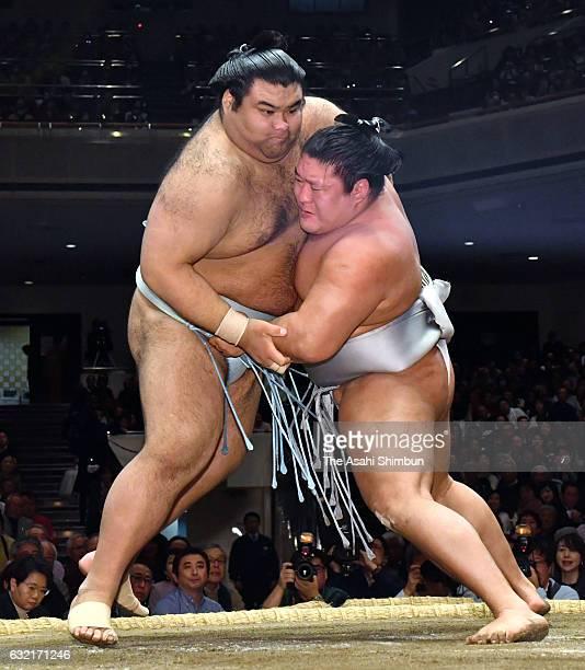 Mongolian wrestler Takanoiwa and komusubi Takayasu compete during day thirteen of the Grand Sumo New Year Tournament at Ryogoku Kokugikan on January...
