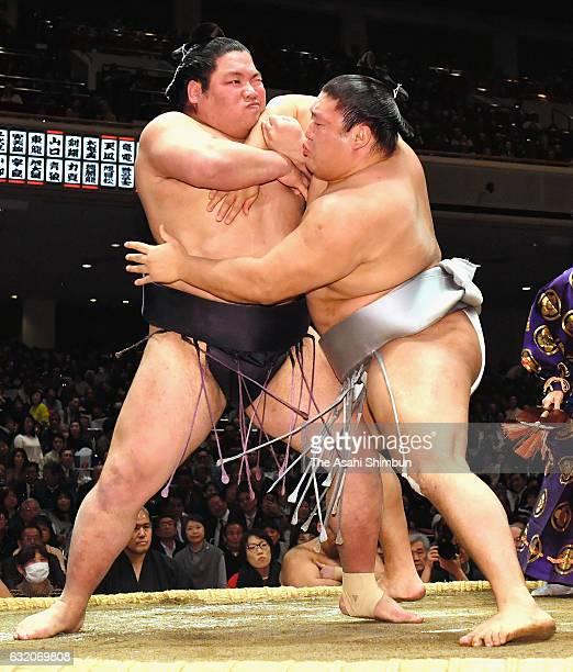 Mongolian wrestler Takanoiwa and Nishikigi compete during day twelve of the Grand Sumo New Year Tournament at Ryogoku Kokugikan on January 19 2017 in...