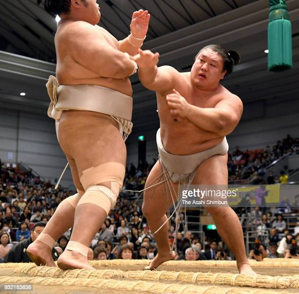 Mongolian wrestler Takanoiwa and Shimanoumi compete in the juryo rank on day two of the Grand Sumo Spring Tournament at Edion Arena Osaka on March 12...