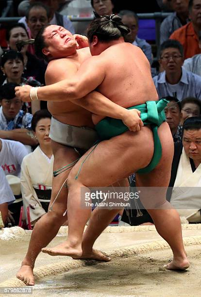 Mongolian wrestler Takanoiwa and Yoshikaze compete in their bout during day fifteen of the Grand Sumo Nagoya Tournament at the Aichi Prefecture...