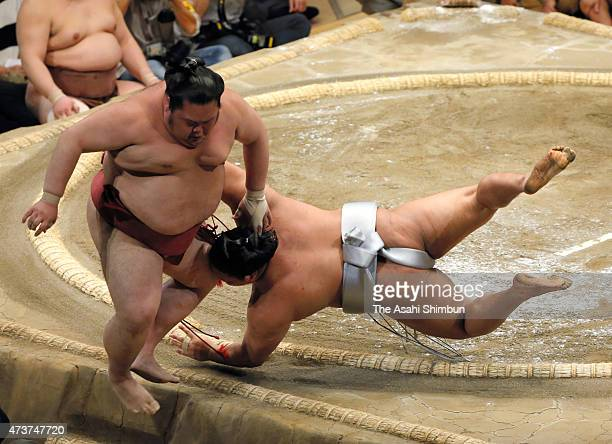 Mongolian wrestler Takanoiwa pushes Chiyomaru out of the ring to win in day eight of the Grand Sumo Summer Tournament at Ryogoku Kokugikan on May 17...