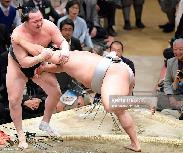 Mongolian wrestler Takanoiwa pushes Mongolian wrestler Chiyoshoma out of the ring to win during day eleven of the Grand Sumo New Year Tournament at...