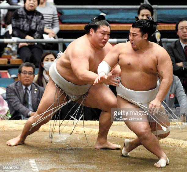 Mongolian wrestler Takanoiwa pushes Tobizaru out of the ring to win in the Juryo rank on day one of the Grand Sumo Spring Tournament at Edion Arena...