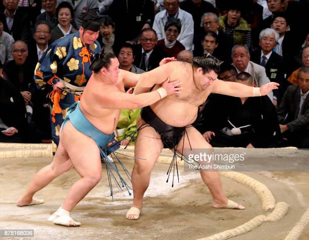 Mongolian wrestler Tamawashi pushes ozeki Takayasu out of the ring to win during day five of the Grand Sumo Kyushu Tournament at Fukuoka Convention...