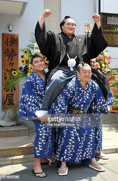 Mongolian wrestler Terunofuji is carried by other sumo wrestlers in celebration of his promotion to ozeki second highest rank in Sumo at Isegahama...